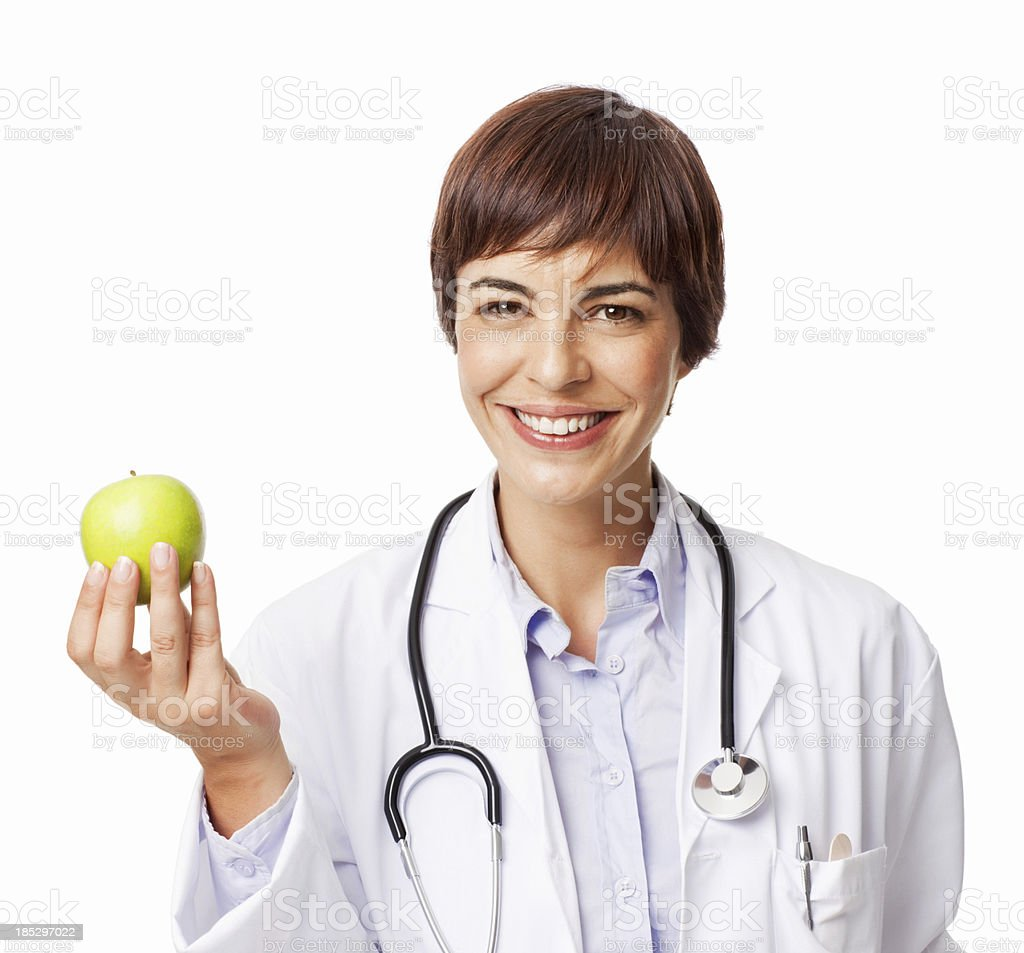 Professional Female Doctor Holding Green Apple - Isolated royalty-free stock photo
