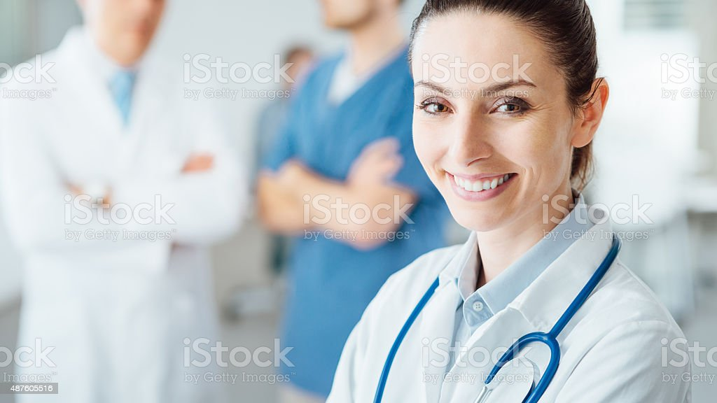 Professional female doctor posing and smiling stock photo