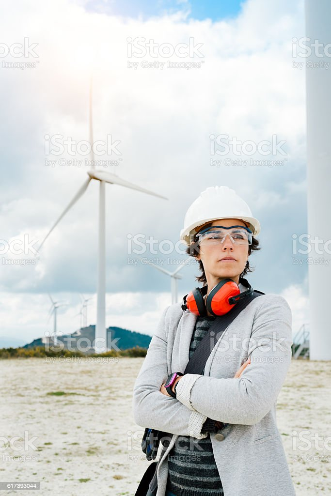 Professional female engineer after technical maintenance at  wind power plant stock photo