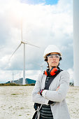 Professional female engineer after technical maintenance at  wind power plant