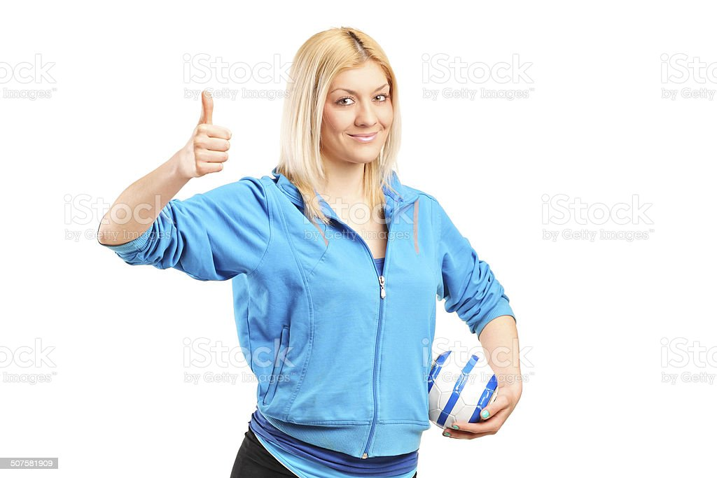 Professional female handball player giving thumb up stock photo