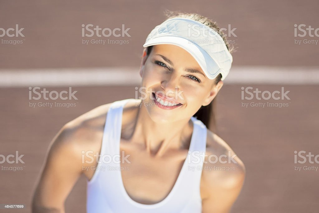 Professional Female Player in Tennis Outfit and Visor stock photo