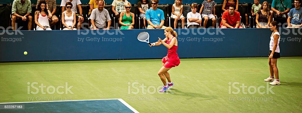 Professional Female Tennis Player Hitting Forehand stock photo