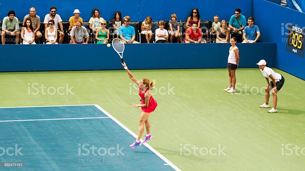 Professional fenake tennis player serving a ball on a tennis stadium,...