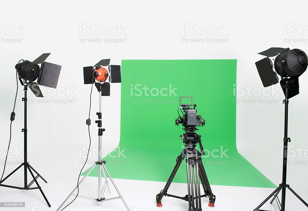 Professional film studio with lights and HD camera