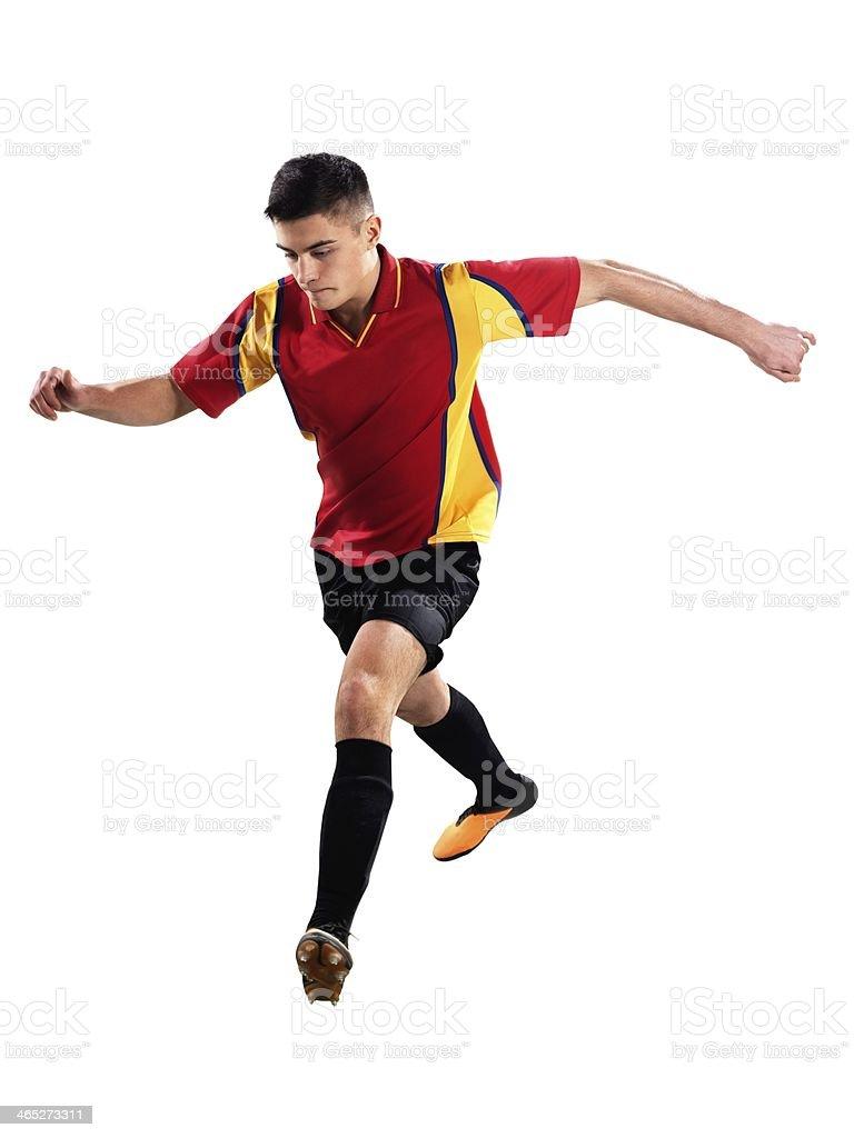 Professional football player kicking royalty-free stock photo