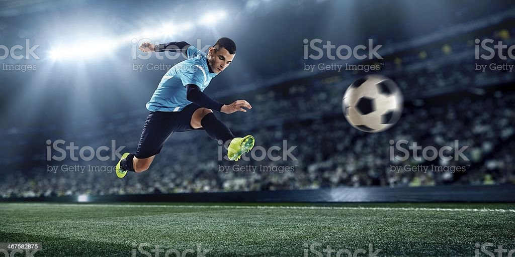 Professional football player soloing on the stadium stock photo