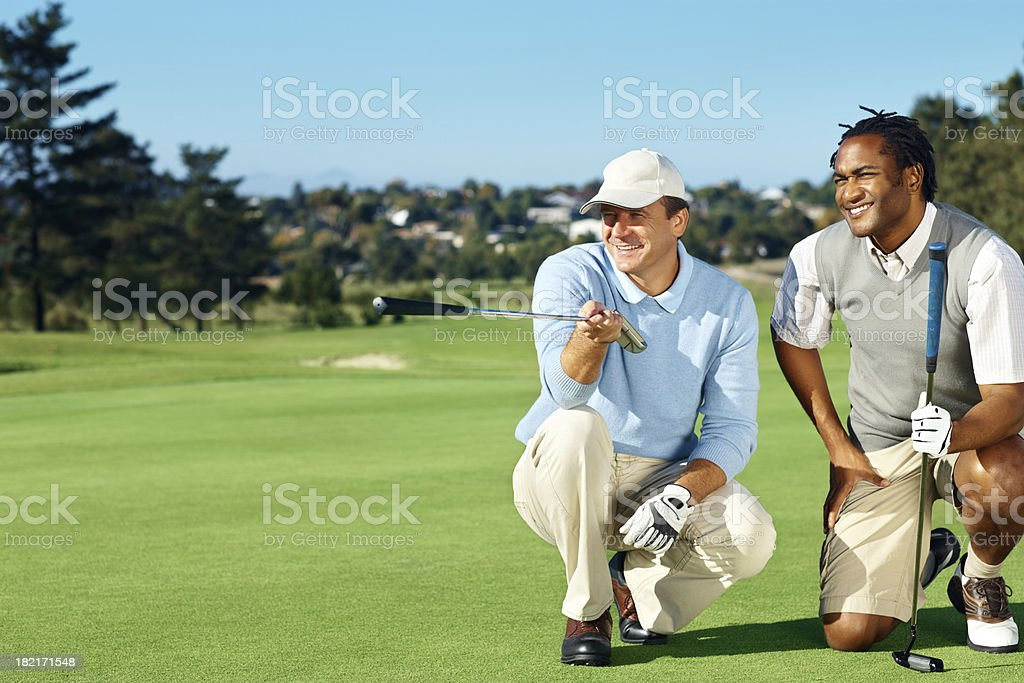 Professional golfers discussing their game plan stock photo