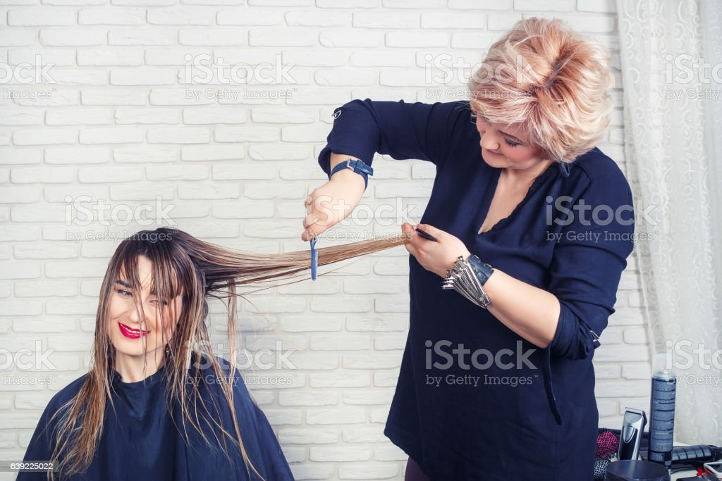 Professional hairdresser making haircut stock photo