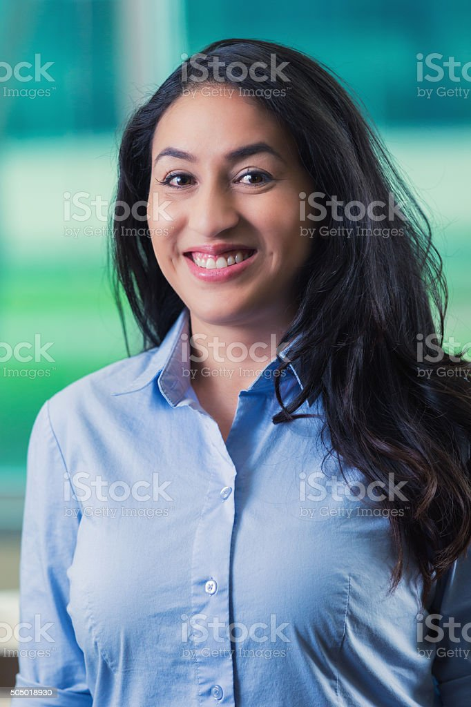 Professional headshot of mid adult Hispanic businesswoman in office stock photo