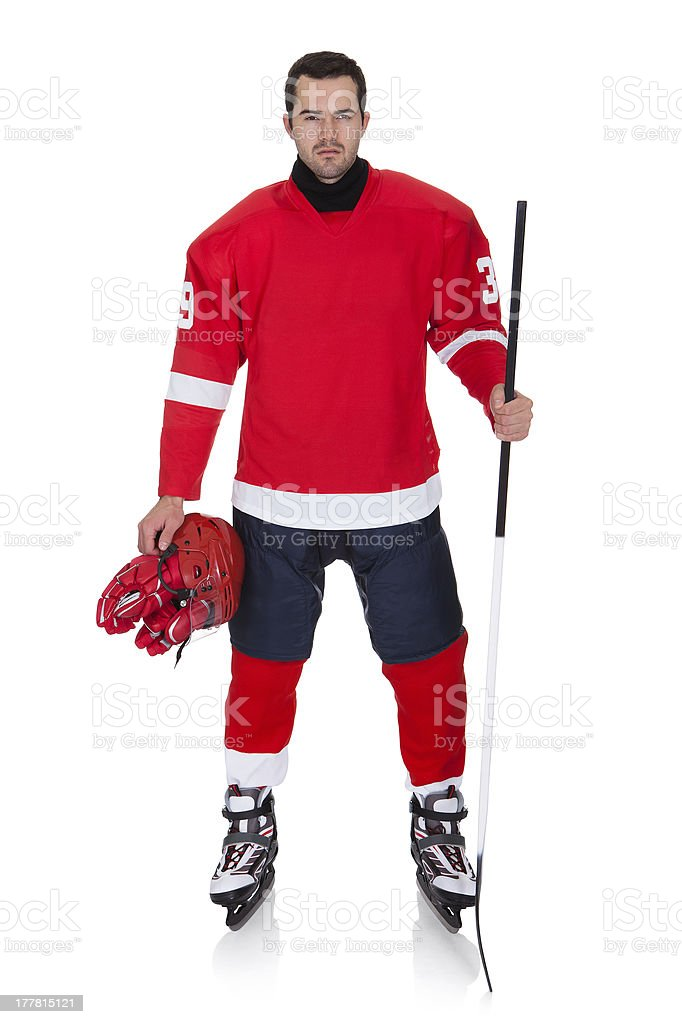 Professional hockey player posing with helmet removed royalty-free stock photo