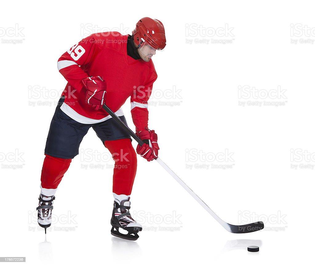 Professional hockey player skating on ice royalty-free stock photo