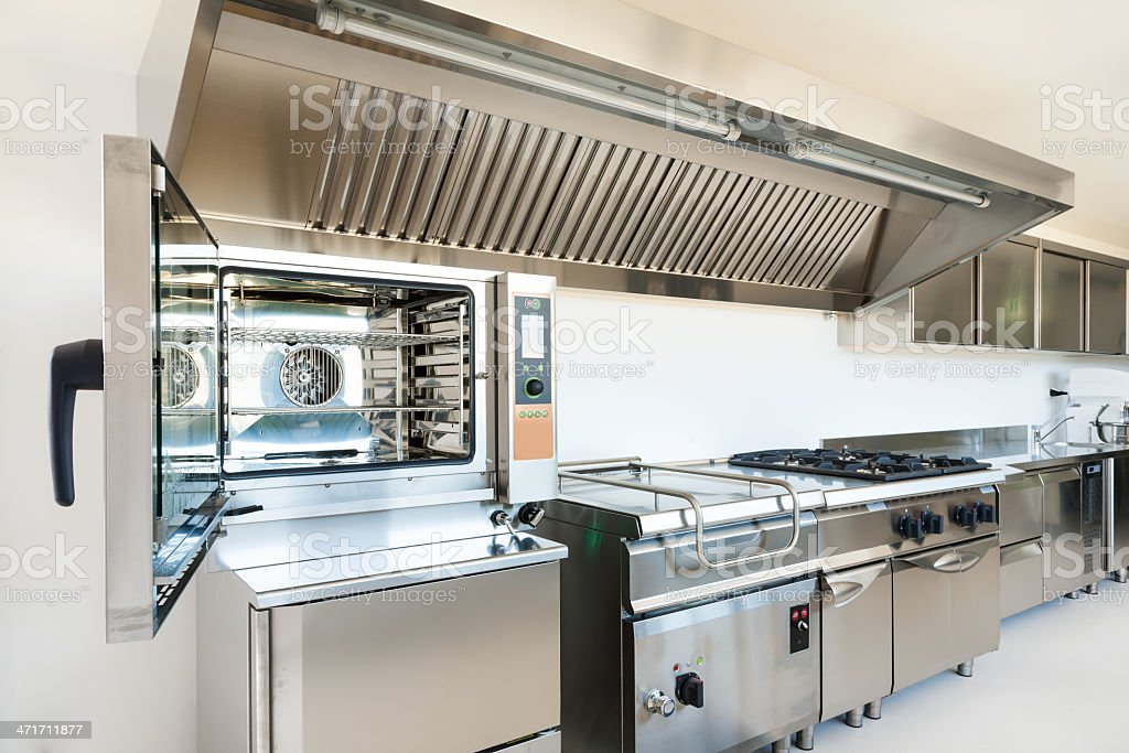 Professional kitchen made from stainless steel appliances stock photo