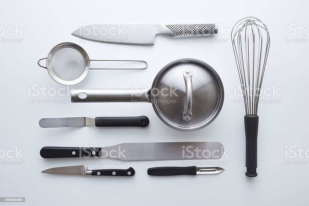 Professional kitchen utensils on white background stock photo