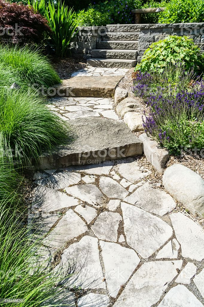 Professional Landscaping With Pavers and Boulders stock photo