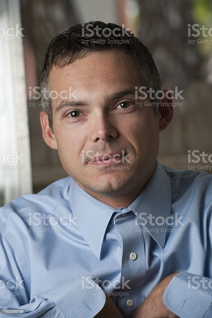 Professional looking well-dressed male sitting royalty-free stock photo
