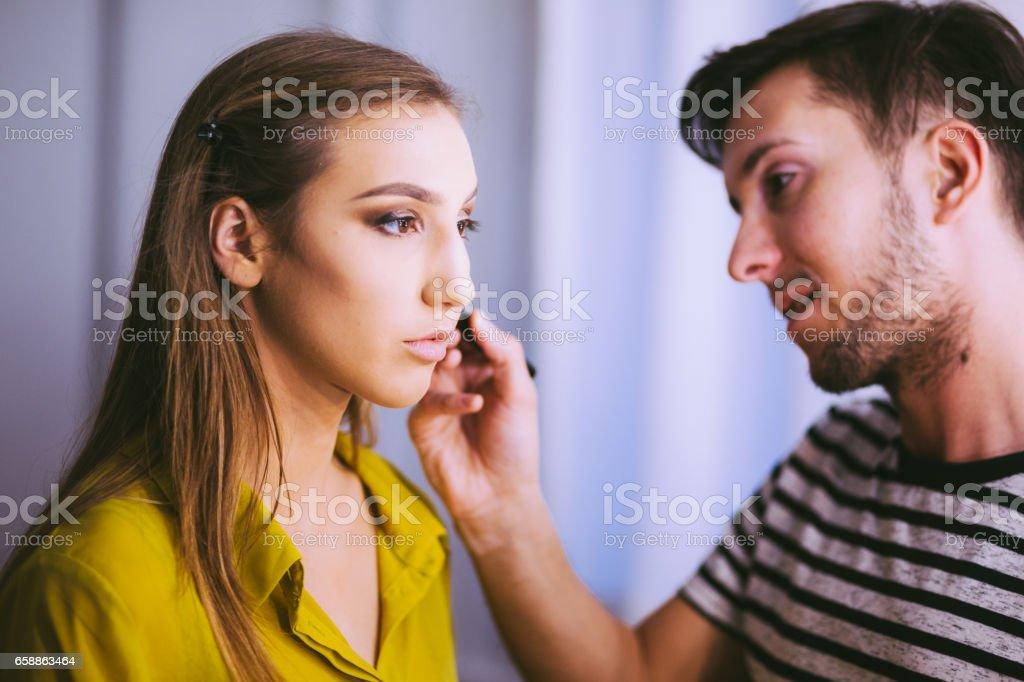 Professional Make Up Artist Make Girl's Cheeks Rosy stock photo