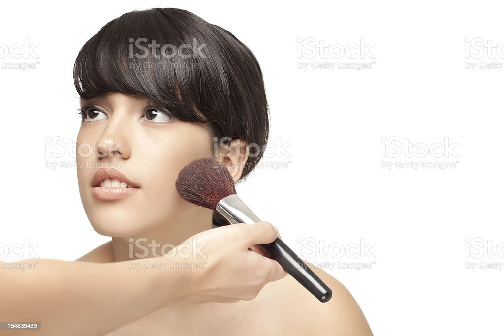 Professional makeup artist putting blush on beautiful woman face. royalty-free stock photo