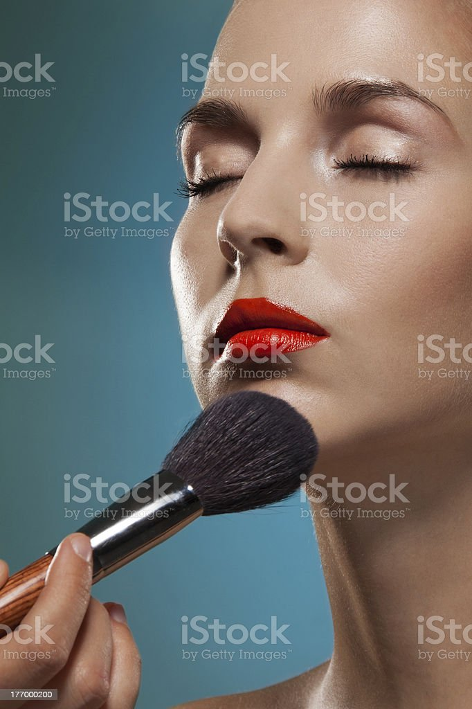 Professional makeup artist working royalty-free stock photo