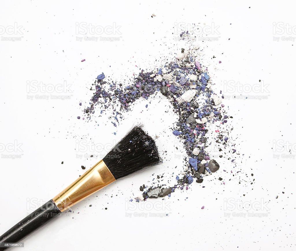 Professional make-up brush on mixed blue crushed eyeshadow stock photo