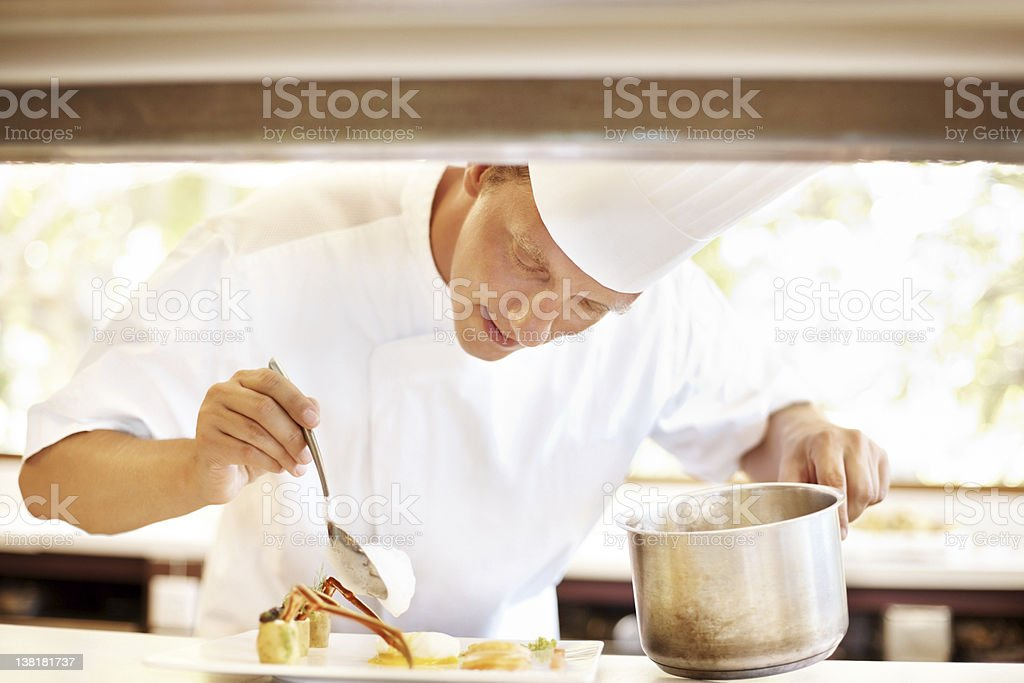 Professional male chef working in kitchen stock photo