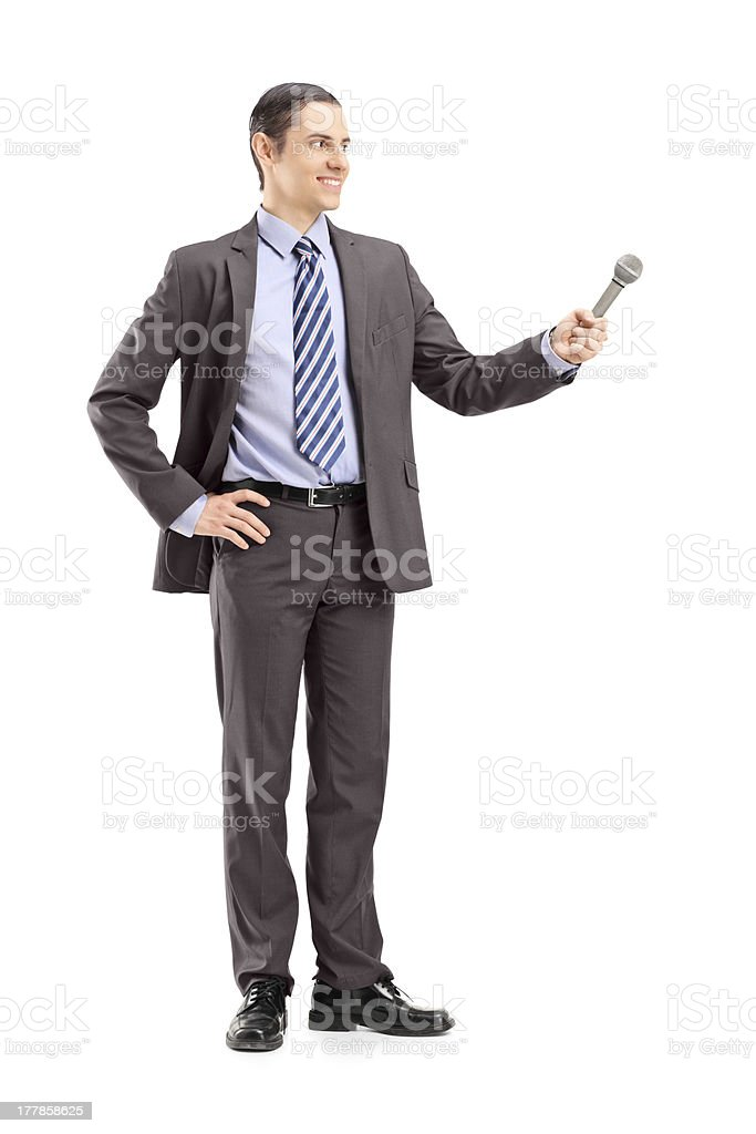 Professional male reporter holding a microphone stock photo