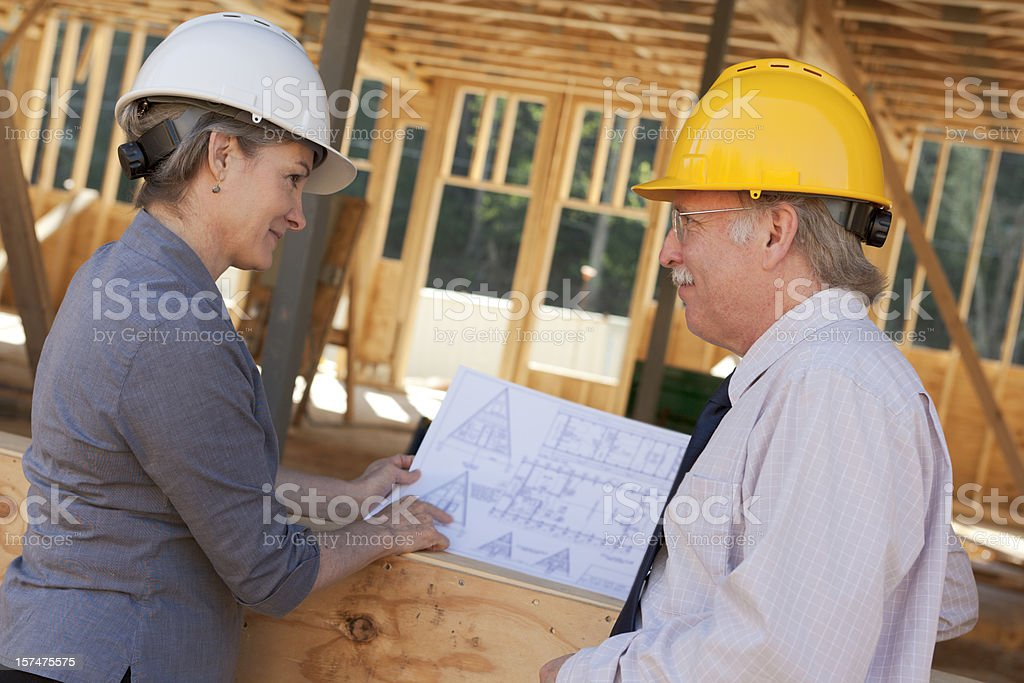 Professional man and woman at construction site (XXL) royalty-free stock photo