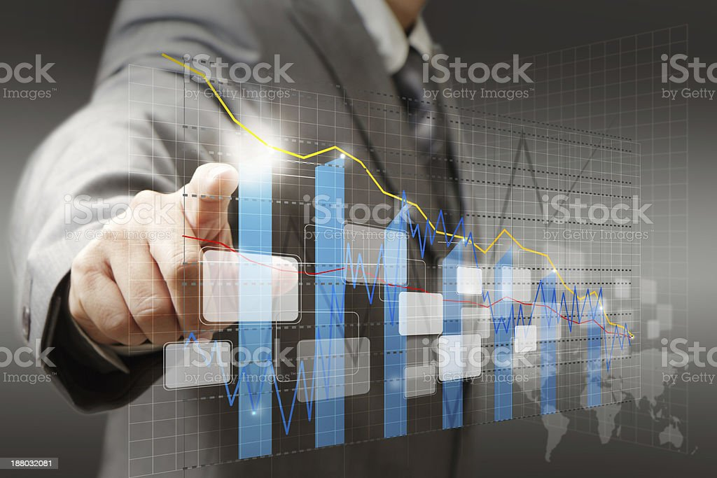 A professional man pointing at a complicated trend analysis royalty-free stock photo