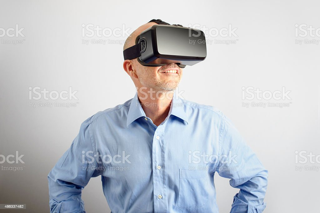 Professional Man Wearing Virtual Reality Headset stock photo