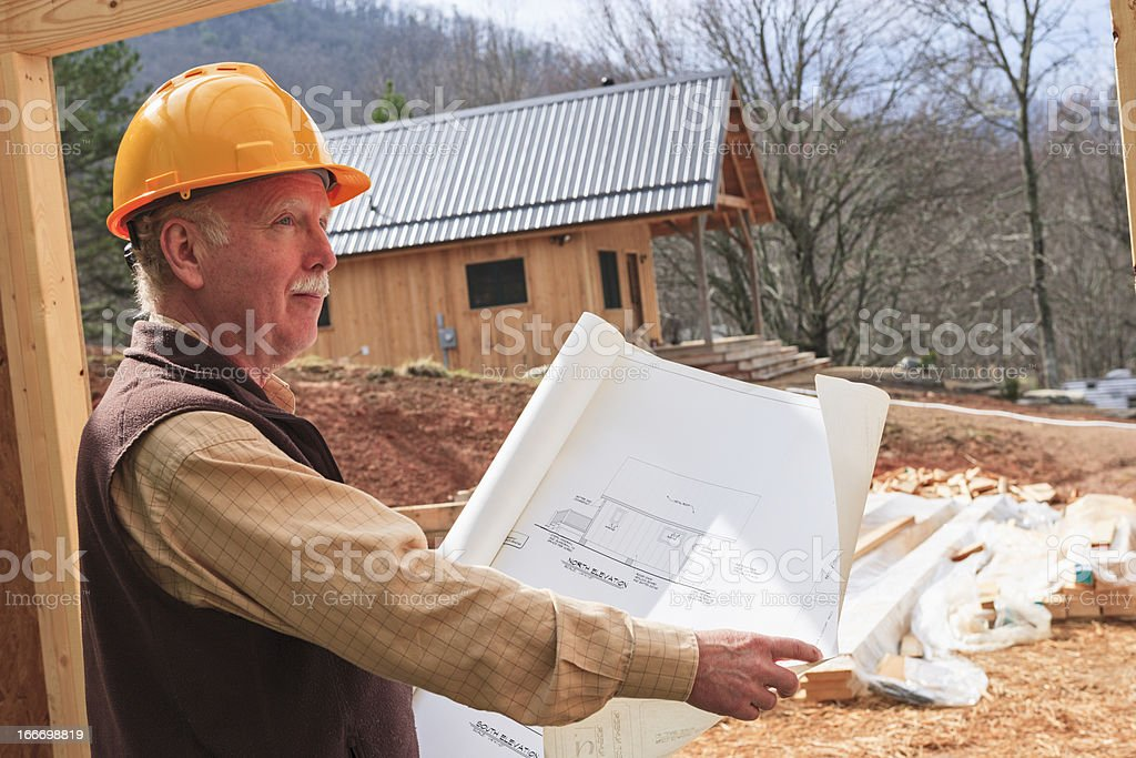 Professional Man working at construction site royalty-free stock photo