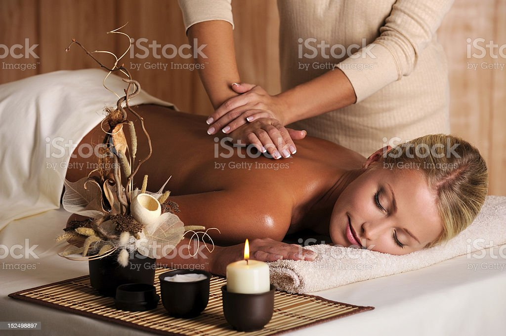 professional masseur doing massage of female back royalty-free stock photo