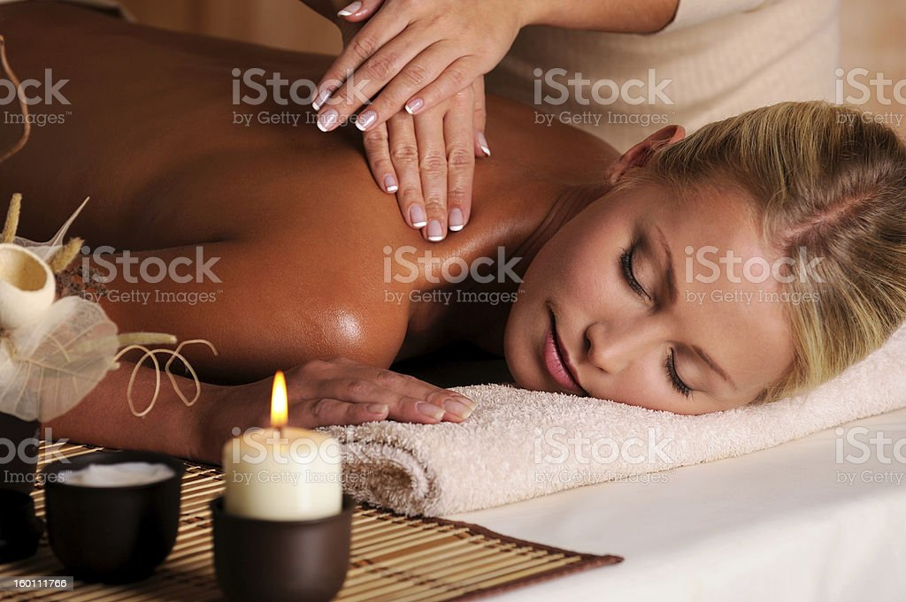 professional masseur doing  massaging  of female neck royalty-free stock photo