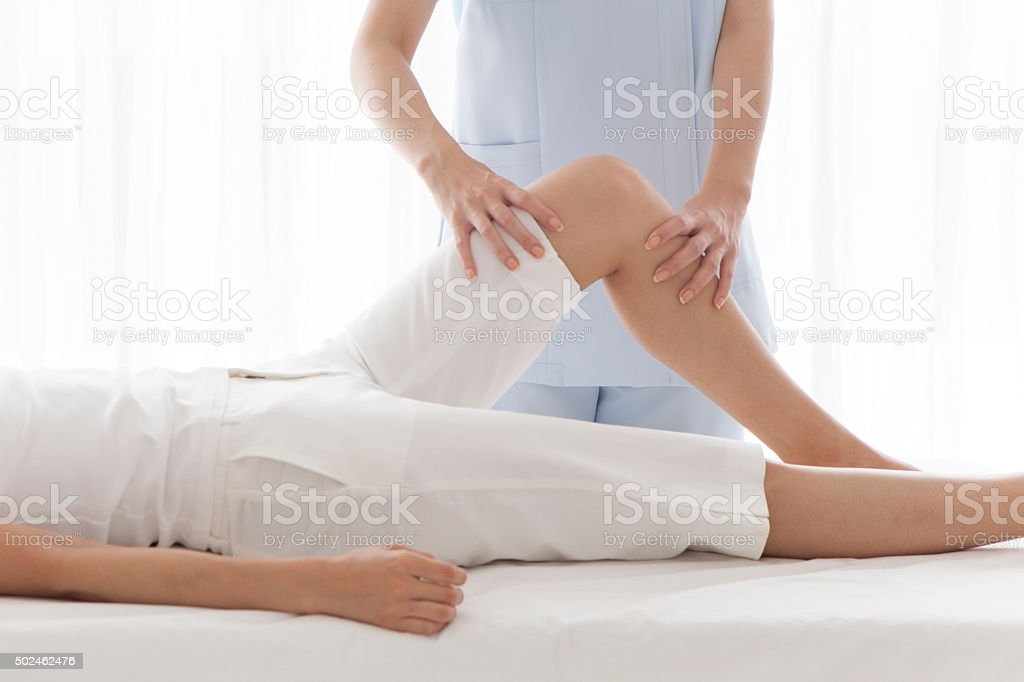 Professional masseur giving a foot massage in a spa stock photo