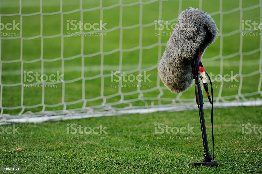 Professional microphone on soccer field stock photo