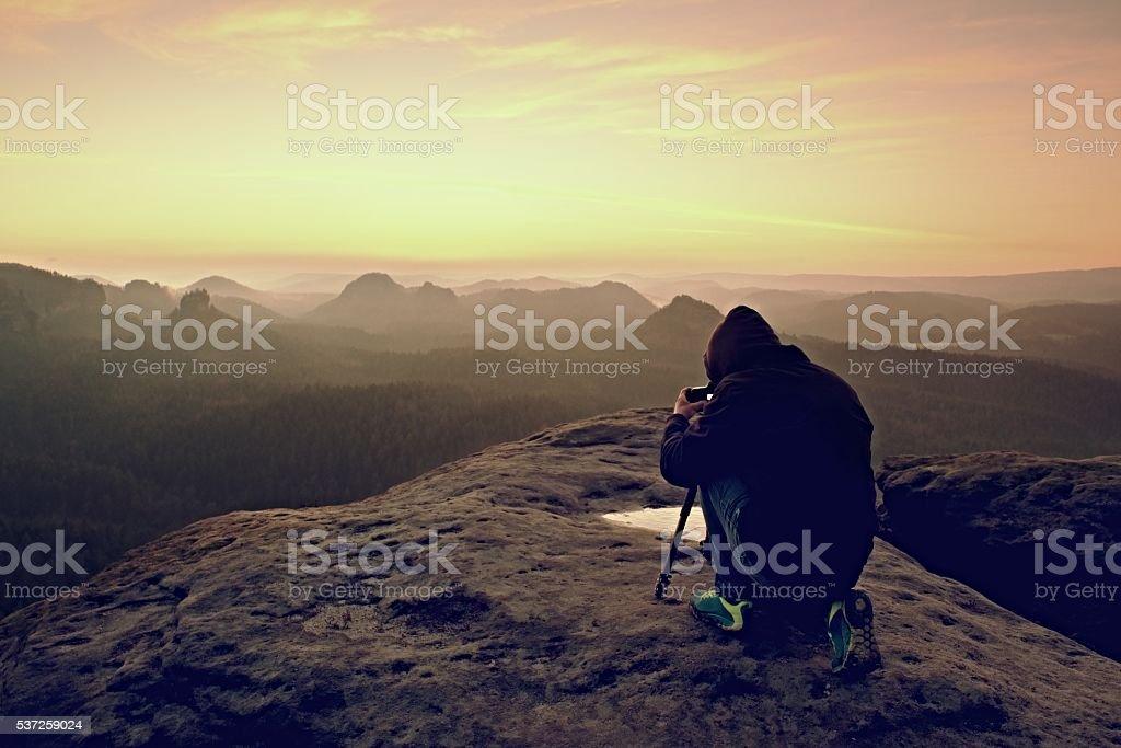 Professional nature photographer takes photos with mirror camera stock photo