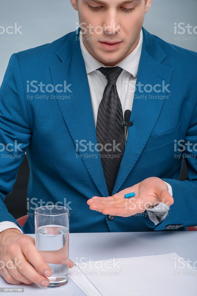 Professional newscaster is about to take a medicine stock photo