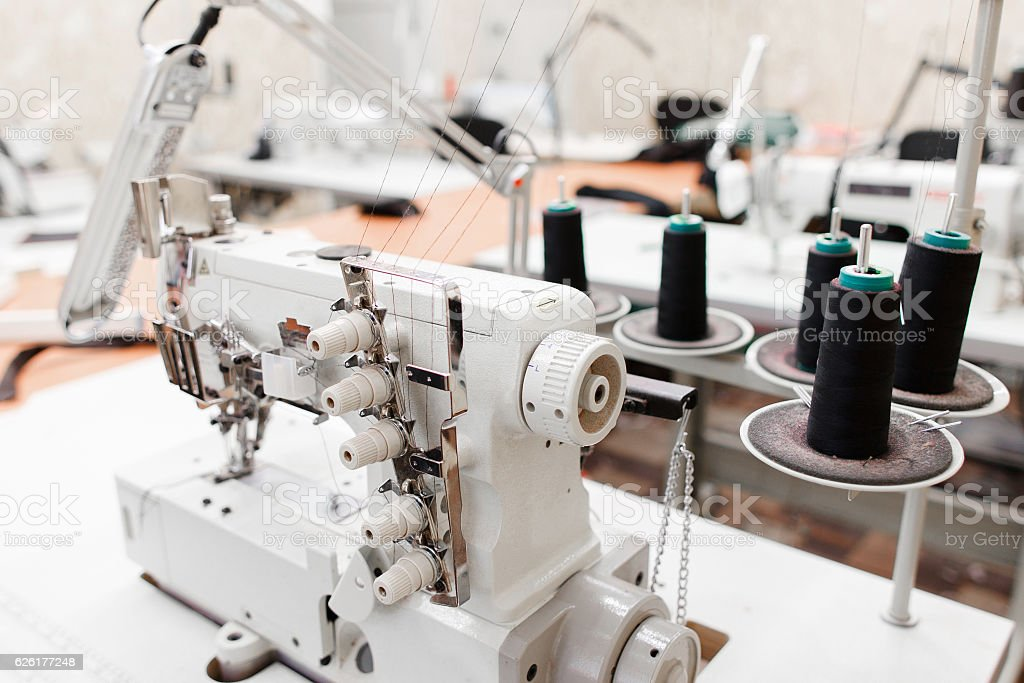 Professional overlock sewing machine in workshop stock photo