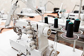 Professional overlock sewing machine in workshop