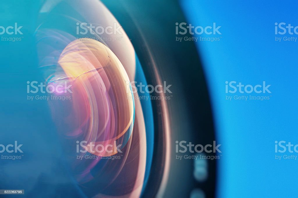 Professional photo lens closeup with colorful reflections. stock photo