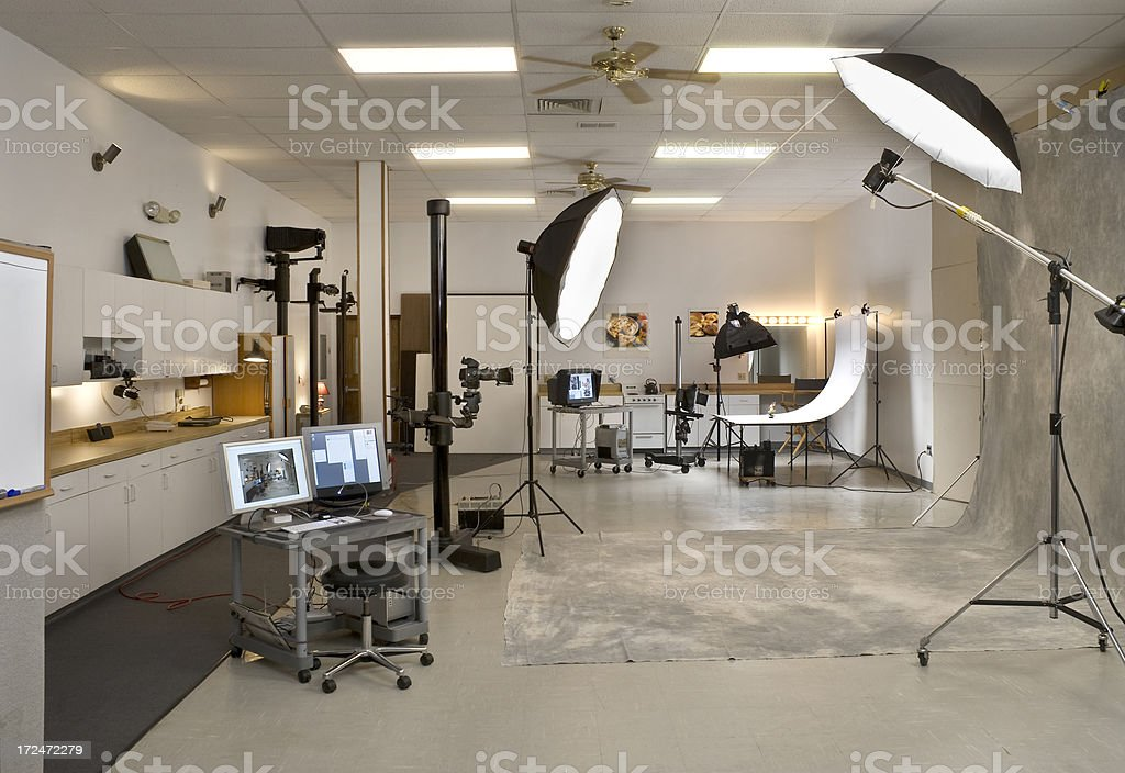 Professional Photo Studio with computer and lighting stock photo