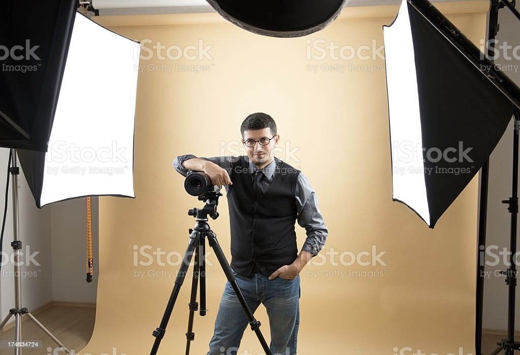 Professional photographer in studio royalty-free stock photo