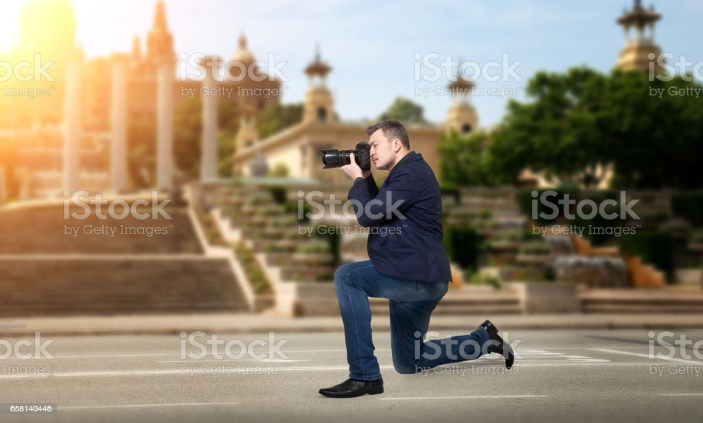 Professional photographer takes pictures of sights stock photo