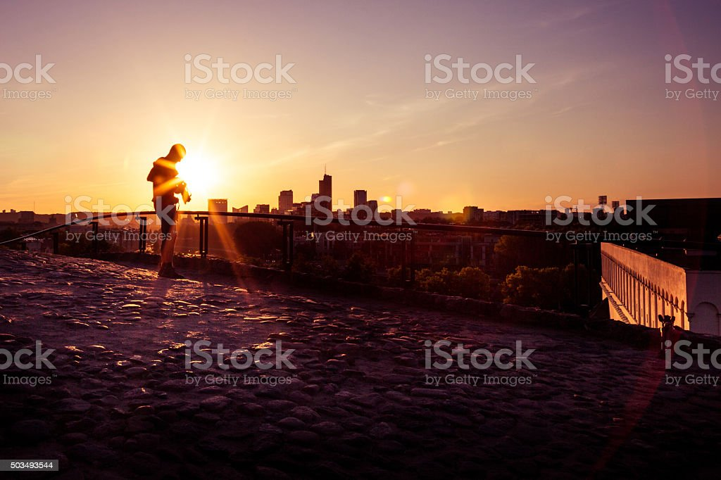 Professional photographer taking city skyline pictures in Vilnius stock photo