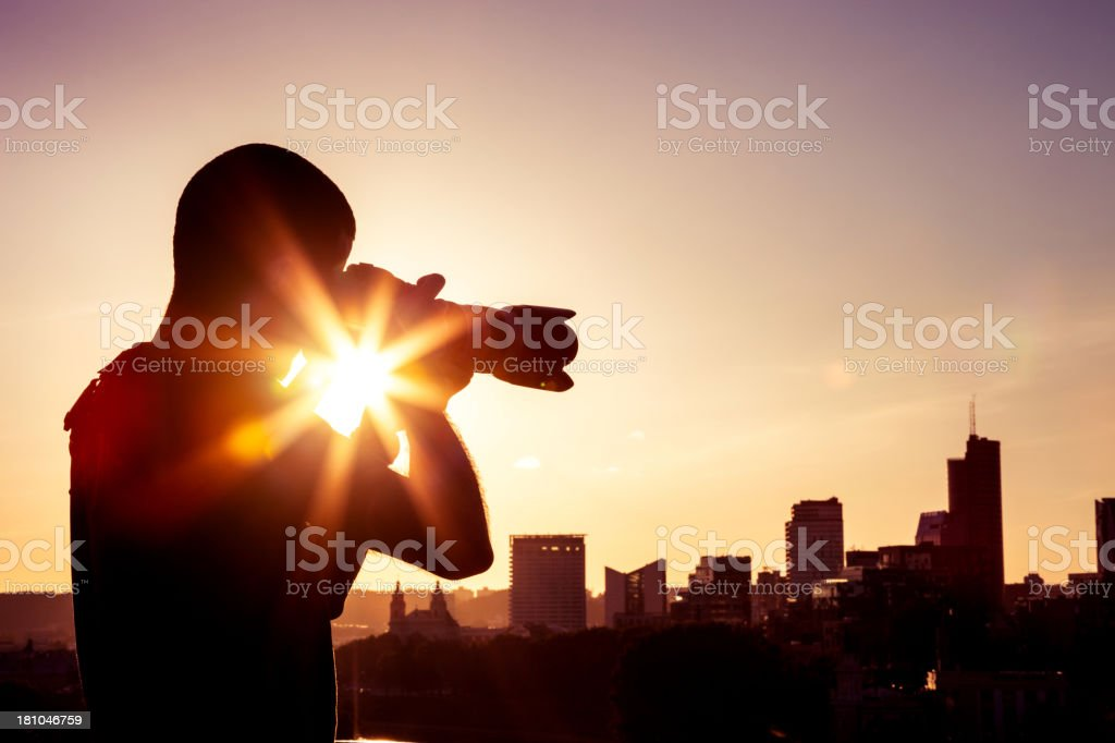 Professional photographer taking city skyline pictures stock photo