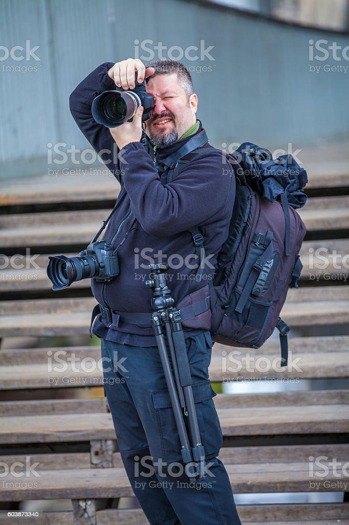 Professional Photographer taking photos stock photo
