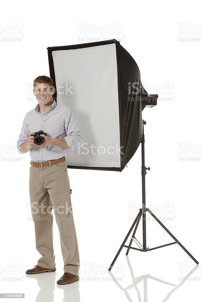Professional photographer with photographic lights stock photo
