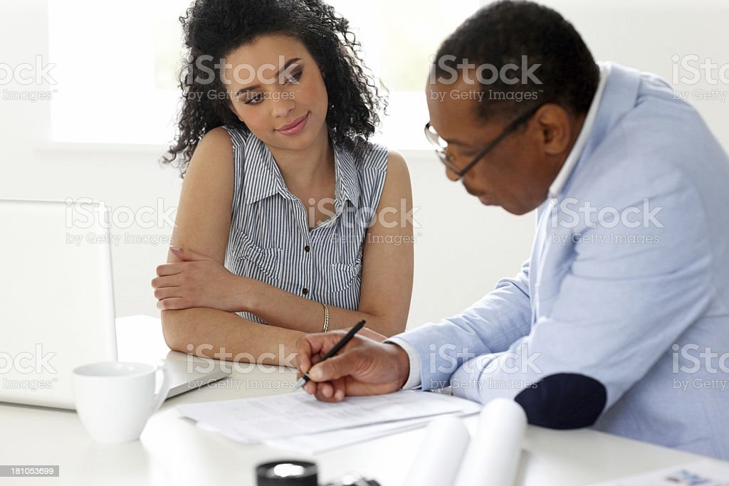Professional photographer working together at desk stock photo