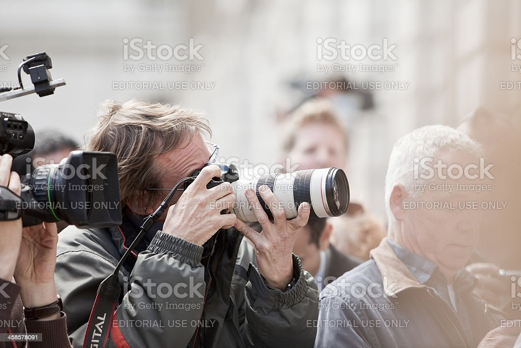 Professional photographers and media gathered at London news event stock photo