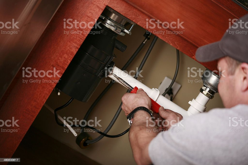 Professional Plumber Installing a Kitchen Sink royalty-free stock photo