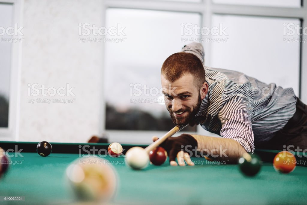 Professional pool player aiming stock photo